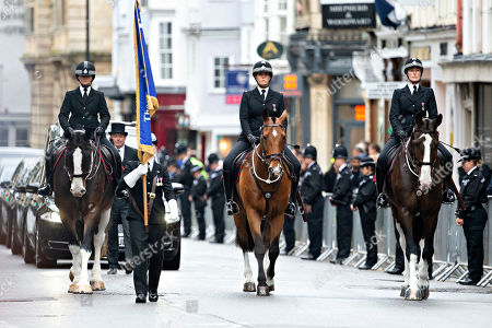 The cortege of PC Andrew Harper comes up Oxford High Street