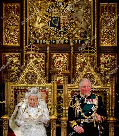 Britain's Queen Elizabeth II (L) reads the Queen's Speech on the The Sovereign's Throne in the House of Lords next to Britain's Prince Charles, Prince Charles (R) during the State Opening of Parliament in the Houses of Parliament