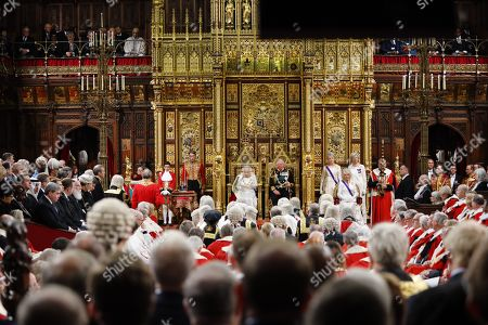 Britain's Queen Elizabeth II (CL) reads the Queen's Speech on the The Sovereign's Throne in the House of Lords next to Britain's Prince Charles, Prince Charles (CR) during the State Opening of Parliament in the Houses of Parliament