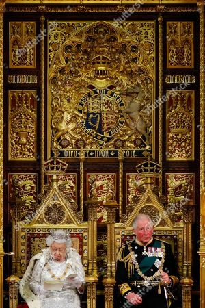 Britain's Queen Elizabeth II (CL) reads the Queen's Speech on the The Sovereign's Throne in the House of Lords next to Britain's Prince Charles (CR) during the State Opening of Parliament in the Houses of Parliament in London on October 14, 2019.
