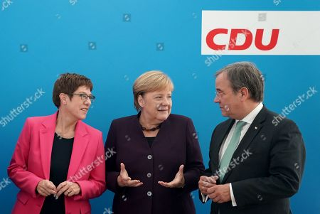 Stock Picture of (L-R) CDU chairwoman and German Defense Minister Annegret Kramp-Karrenbauer, German Chancellor Angela Merkel and North Rhine-Westphalian Prime Minister Armin Laschet talk during a board meeting of the Christian Democratic Union (CDU) at CDU headquarters in Berlin, Germany, 14 October 2019