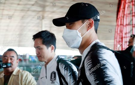 Stock Picture of South Korea captain Son Heung-min (R) leaves the Beijing Capital International Airport, in Beijing, China, 14 October 2019, en route to North Korea. The team was traveling to Pyongyang for a FIFA World Cup qualifier against North Korea on 15 October.