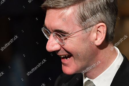 Britain's Leader of the House of Commons Jacob Rees-Mogg reacts as he attends the State Opening of Parliament in the Houses of Parliament in London