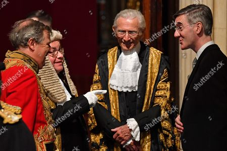 Britain's Leader of the House of Commons Jacob Rees-Mogg (R) reacts as he attends the State Opening of Parliament in the Houses of Parliament in London