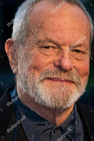 Terry Gilliam poses for photographers upon arrival at the premiere of the film 'The Irishman' as part of the London Film Festival, in central London