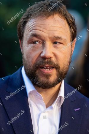 Stephen Graham poses for photographers upon arrival at the premiere of the film 'The Irishman' as part of the London Film Festival, in central London