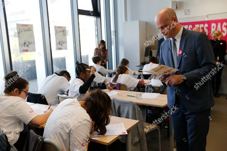 French Education and Youth Affairs Minister Jean-Michel Blanquer dictates to pupils during a visit at a school in Paris, France, 14 October 2019. A former teacher herself, French first lady Brigitte Macron returned to the classroom for a charity dictate in support of the European Leucodystrophie Association (ELA).