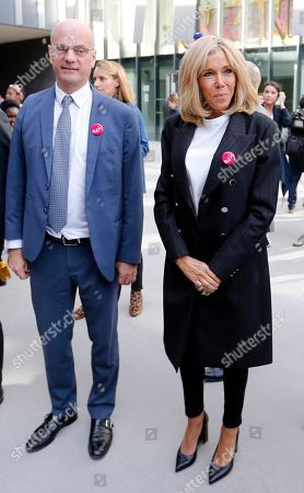 Brigitte Macron, wife of French President Emmanuel Macron, and French Education and Youth Affairs Minister Jean-Michel Blanquer leave after a visit at a school in Paris, France, 14 October 2019. A former teacher herself, French first lady Brigitte Macron returned to the classroom for a charity dictate in support of the European Leucodystrophie Association (ELA).
