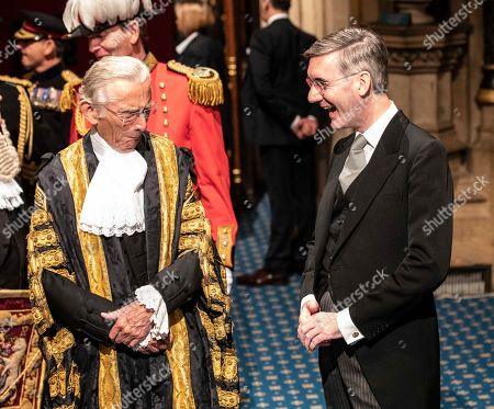 Stock Image of Leader of the house of commons, Jacob Rees-Mogg, talks with speaker of the Lords Norman Fowler following the Queens speech at the state opening of Parliament.