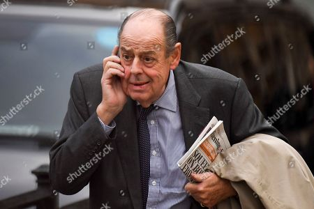 Nicholas Soames MP makes his way out of the Houses of Parliament following the Queen's Speech in London