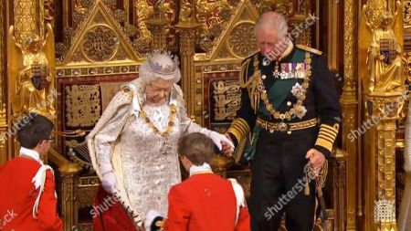 A grab from a handout video made available by the UK Parliamentary Recording Unit shows Britain's Queen Elizabeth II (L) and Charles, Prince of Wales (R) taking their seats on the throne at the House of Lords in London, Britain, 14 October 2019. The Queen will read a speech from the the throne in the House of Lords and open Parliament.