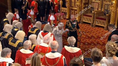 Stock Image of A grab from a handout video made available by the UK Parliamentary Recording Unit shows Britain's Queen Elizabeth II (L) and Charles, Prince of Wales (R) leaving after her speech at the House of Lords in London, Britain, 14 October 2019. The Queen will read a speech from the the throne in the House of Lords and open Parliament.