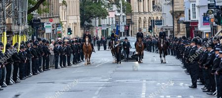 A funeral cortege makes it way down the High Street which is lined by police officers in Oxford city centre for the funeral of Thames Valley Police officer PC Andrew Harper.