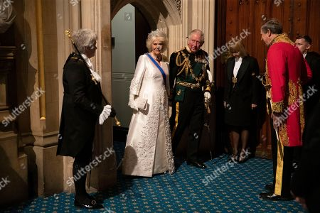 Stock Photo of Britain's Prince Charles, third left, and his wife Camilla the Duchess of Cornwall, second left, arrive in the Norman Porch, flanked at left by Black Rod, Sarah Clarke the first ever female to serve in the role of Black Rod, at the Palace of Westminster and the Houses of Parliament for the State Opening of Parliament ceremony in London