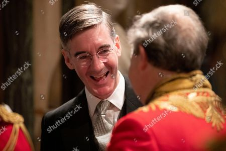 Stock Picture of Britain's Leader of the House of Commons Jacob Rees-Mogg talks with a dignitary before the arrival of Britain's Queen Elizabeth II in the Norman Porch at the Palace of Westminster and the Houses of Parliament for the State Opening of Parliament ceremony in London