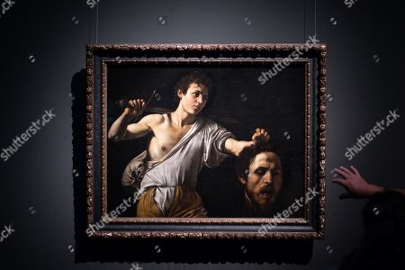 A visitor points at the painting 'David with the Head of Goliath' by Italien artist Michelangelo Merisi da Caravaggio during a press preview of the Caravaggio & Bernini exhibition at the Kunsthistorisches Museum (Museum of Art History) in Vienna, Austria, 14 October 2019. The exhibition will open on 17 April and run through 19 January 2020.