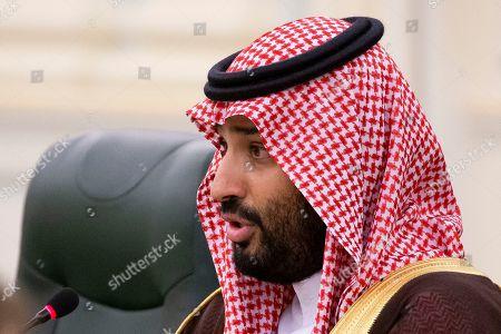 Saudi Arabia's Crown Prince Mohammad bin Salman bin Abdulaziz Al Saud speaks to Russian President Vladimir Putin (not pictured) during the talks in Riyadh, Saudi Arabia, 14 October 2019. Russian President Vladimir Putin pays a state visit to Saudi Arabia.