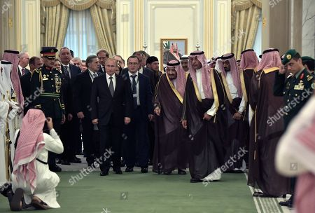 Russian President Vladimir Putin (front C-L) and Saudi Arabia's King Salman bin Abdulaziz Al Saud (front C- R) prior to a signing ceremony following their talks at the Saudi Royal palace in Riyadh, Saudi Arabia, 14 October 2019. Russian President Vladimir Putin pays a state visit to Saudi Arabia.