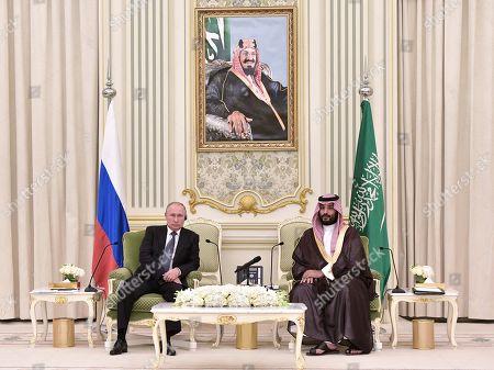 Stock Photo of Russian President Vladimir Putin (L) and Saudi Arabia's Crown Prince Mohammad bin Salman bin Abdulaziz Al Saud (R) attend a meeting at the Saudi Royal palace in Riyadh, Saudi Arabia, 14 October 2019. Russian President Vladimir Putin pays a state visit to Saudi Arabia.