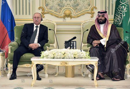 Stock Image of Russian President Vladimir Putin (L) and Saudi Arabia's Crown Prince Mohammad bin Salman bin Abdulaziz Al Saud (R) attend a meeting at the Saudi Royal palace in Riyadh, Saudi Arabia, 14 October 2019. Russian President Vladimir Putin pays a state visit to Saudi Arabia.