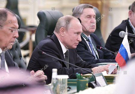 Russian President Vladimir Putin (C) attends a meeting with Saudi Arabia's King Salman bin Abdulaziz Al Saud (not pictured) at the Saudi Royal palace in Riyadh, Saudi Arabia, 14 October 2019. Russian President Vladimir Putin pays a state visit to Saudi Arabia.