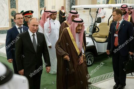 Salman, Vladimir Putin. Russian President Vladimir Putin, second from left, and Saudi Arabia's King Salman, center, arrive for talks in Riyadh, Saudi Arabia, . Putin traveled to Saudi Arabia on Monday, meeting with the oil-rich nation's king and crown prince as he seeks to cement Moscow's political and energy ties across the Mideast