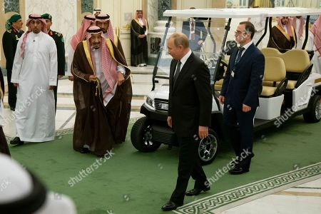 Stock Image of Salman, Vladimir Putin. Russian President Vladimir Putin, center right, and Saudi Arabia's King Salman, center left, arrive for talks in Riyadh, Saudi Arabia, . Putin traveled to Saudi Arabia on Monday, meeting with the oil-rich nation's king and crown prince as he seeks to cement Moscow's political and energy ties across the Mideast