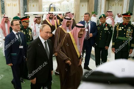 Stock Photo of Salman, Vladimir Putin. Russian President Vladimir Putin, second from left, and Saudi Arabia's King Salman, center, arrive for the talks in Riyadh, Saudi Arabia, . Putin traveled to Saudi Arabia on Monday, meeting with the oil-rich nation's king and crown prince as he seeks to cement Moscow's political and energy ties across the Mideast