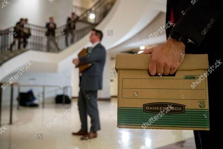 Staff hold files as Rep. Jim Jordan, R-Ohio, ranking member of the Committee on Oversight Reform and Rep. Lee Zeldin R-N.Y., speak to reporters following a closed door meeting on Capitol Hill in Washington, where former White House advisor on Russia, Fiona Hill, testified before congressional lawmakers as part of the House impeachment inquiry into President Donald Trump