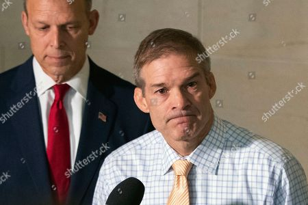 Jim Jordan, Scott Perry. Rep. Jim Jordan, R-Ohio, ranking member of the Committee on Oversight Reform, and Rep. Scott Perry, R-Pa., left, listen to reporters questions upon arrival on Capitol Hill in Washington