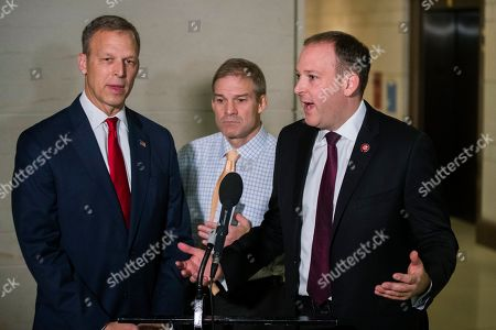 Jim Jordan, Scott Perry, Lee Zeldin. From left; Rep. Scott Perry, R-Pa., Rep. Jim Jordan, R-Ohio, ranking member of the Committee on Oversight Reform and Rep. Lee Zeldin, R-N.Y., speaks to reporters upon arrival on Capitol Hill in Washington