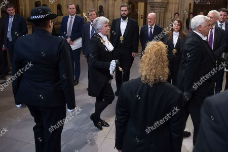 Black Rod Sarah Clarke walks through the Member's Lobby in the House of Commons for the State Opening of Parliament at Houses Of Parliament