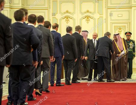 A handout photo made available by Saudi Royal Court shows Saudi King Salman bin Abdulaziz Al Saud (C-R) receiving the accompanying delegation of visiting Russian President Vladimir Putin (C-L) at the Saudi Royal palace in Riyadh, Saudi Arabia, 14 October 2019. Russian President Vladimir Putin pays a state visit to Saudi Arabia.