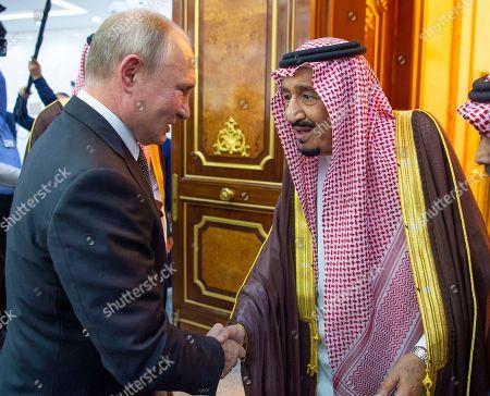 A handout photo made available by Saudi Royal Court shows Saudi King Salman bin Abdulaziz Al Saud (R) receiving Russian President Vladimir Putin (L) at the Saudi Royal palace in Riyadh, Saudi Arabia, 14 October 2019. Russian President Vladimir Putin pays a state visit to Saudi Arabia.