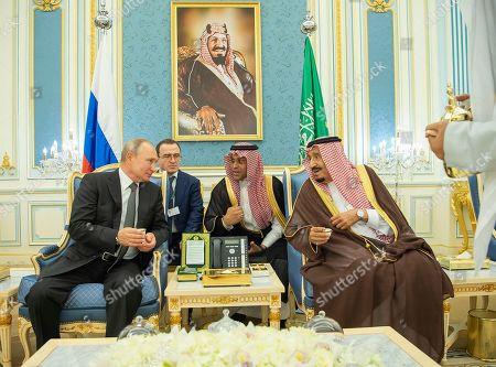 A handout photo made available by Saudi Royal Court shows Saudi King Salman bin Abdulaziz Al Saud (R) meeting with Russian President Vladimir Putin (L) at the Saudi Royal palace in Riyadh, Saudi Arabia, 14 October 2019. Russian President Vladimir Putin pays a state visit to Saudi Arabia.