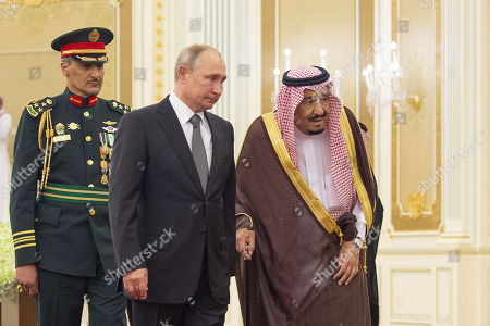 A handout photo made available by Saudi Royal Court shows Saudi King Salman bin Abdulaziz Al Saud (R) receiving Russian President Vladimir Putin (2-R) at the Saudi Royal palace in Riyadh, Saudi Arabia, 14 October 2019. Russian President Vladimir Putin pays a state visit to Saudi Arabia.