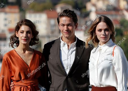 Jakob Oftebro (C), Swedish actresses Nina Zanjani (L) and Katia Winter (R) pose during a photocall for the TV series 'Agent Hamilton' at the annual MIPCOM television content market in Canneâ??s, France, 14 October 2019. The media event runs from 14 to 17 October.