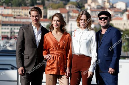 Jakob Oftebro (L), Swedish actresses Nina Zanjani (2-L), Katia Winter (2-R) and Swedish director Erik Leijonborg (R) pose during a photocall for the TV series 'Agent Hamilton' at the annual MIPCOM television content market in Canneâ??s, France, 14 October 2019. The media event runs from 14 to 17 October.