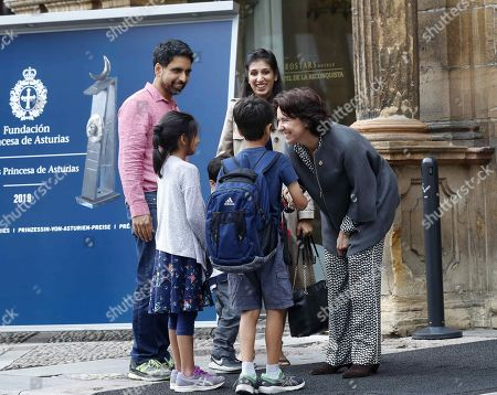 The director of Princess of Asturias Foundation Teresa Sanjurjo (R) receives US engineer and mathematician Salman Khan (L), who will be awarded with the Princess of Asturias Award for International Cooperation, next to his family during his arrival to Oviedo, Spain, 14 September 2019. The Princess of Asturias Awards are given every year to personalities or organizations from all around the world who make significant achievements in the sciences, arts, literature, humanities and sports. Khan will receive the award on 18 October 2019.