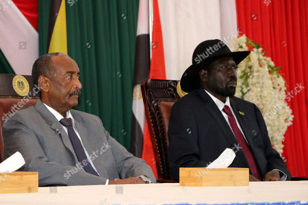 President of the Sudanese Transitional Council General Abdulfattah Al Burhan (L) and South Sudan's President Salva Kiir Mayardit (R) attend the opening session of peace talks between Sudan ruling council and rebels, in Juba, South Sudan, 14 October 2019. According to reports, Juba is hosting peace talks between the ruling transitional council in Sudan and rebel leaders that aim to end years-long multiple conflicts in Sudan.