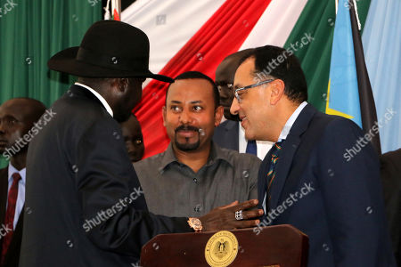 Stock Image of South Sudan's President Salva Kiir Mayardit (L) speaks with Ethiopian Prime Minister Abiy Ahmed (C) and Egyptian Prime Minister Mostafa Madbouly (R) during the opening session of peace talks between Sudan ruling council and rebels, in Juba, South Sudan, 14 October 2019. According to reports, Juba is hosting peace talks between the ruling transitional council in Sudan and rebel leaders that aim to end years-long multiple conflicts in Sudan.