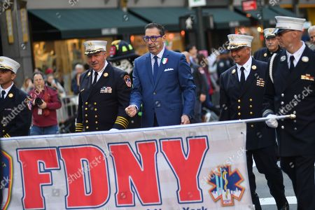 Stock Picture of New York City Fire Commissioner Daniel Negro marches in the 75th Anniversary Columbus Day Parade on Fifth Avenue