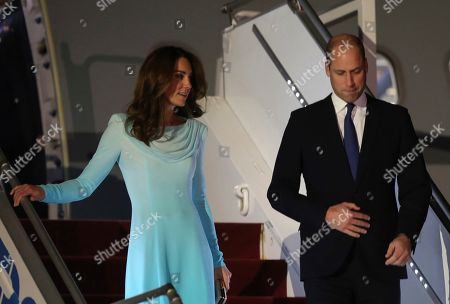 Britain's Prince William and his wife Catherine Duchess of Cambridge arrive at Nur Khan base in Islamabad, Pakistan. They are on a five-day visit, which authorities say will help further improve relations between the two countries