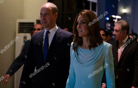 Britain's Prince William and his wife Catherine Duchess of Cambridge arrive at the Nur Khan base in Islamabad, Pakistan. They are on a five-day visit, which authorities say will help further improve relations between the two countries