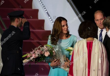 Stock Picture of Britain's Prince William and his wife Catherine Duchess of Cambridge arrive at the Nur Khan base in Islamabad, Pakistan. They are on a five-day visit, which authorities say will help further improve relations between the two countries