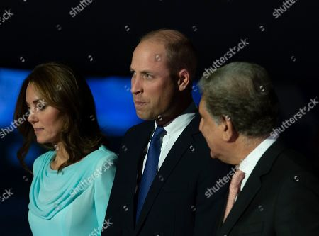 Stock Image of Pakistani Foreign Minister Shah Mehmood Qureshi, right, escorts Britain's Prince William and his wife Catherine Duchess of Cambridge as they arrive at the Nur Khan base in Islamabad, Pakistan,. They are on a five-day visit, which authorities say will help further improve relations between the two countries