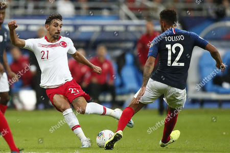 Corentin Tolisso (R) of France and Irfan Can Kahveci (L) of Turkey in action during the UEFA EURO 2020 qualifier soccer match between France and Turkey held at Stade de France Stadium in Paris, France, 14 October 2019.
