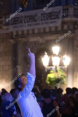 A demonstrator reacts during a protest against the sentence ruled by Supreme Court on 'proces' trial' at Plaza Sant Jaume square in Barcelona, Spain, 14 October 2019. Demonstrators are blocking also some roads in Catalan capital against the court's decision. Spanish Supreme Court condemned Oriol Junqueras to 13 years in jail for sedition, Carme Forcadell to 11 years and half for sedition; Jordi Cuixart and Jordi Sanchez were sentenced to 9 years and half for sedition; former regional Minister Jordi Turull, Raul Romeva and Dolors Bassa were sentenced to 12 years in jail for sedition and missapropriation, and Joaquin Forn and Josep Rull were condenmend 10 years an half for sedition. The three other defendants were absolved.