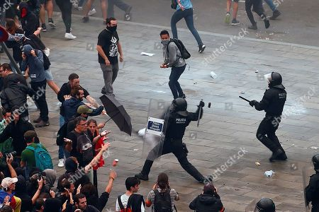 Mossos d'Esquadra Catalan police officers clash with demonstrators during the rally called by the group called 'Tsunami Democratic' (Democratic Tsunami) for 'shutting-down' the Barcelona-El Prat international airport against the sentence ruled by Supreme Court on 'proces' trial', in Barcelona, Catalonia, 14 October 2019. Demonstrators are blocking some roads in Catalan capital against the court's decision. Spanish Supreme Court condemned Oriol Junqueras to 13 years in jail for sedition, Carme Forcadell to 11 years and half for sedition; Jordi Cuixart and Jordi Sanchez were sentenced to 9 years and half for sedition; former regional Minister Jordi Turull, Raul Romeva and Dolors Bassa were sentenced to 12 years in jail for sedition and missapropriation, and Joaquin Forn and Josep Rull were condenmend to 10 years an half for sedition. The three other defendants were absolved.