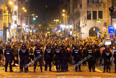 Riot police form a line at the Via Laietana during a protest against the sentence ruled by Supreme Court on 'proces' trial' in Barcelona, Spain, 14 October 2019. Demonstrators are blocking also some roads in Catalan capital against the court's decision. Spanish Supreme Court condemned Oriol Junqueras to 13 years in jail for sedition, Carme Forcadell to 11 years and half for sedition; Jordi Cuixart and Jordi Sanchez were sentenced to nine and a half years for sedition; former regional Minister Jordi Turull, Raul Romeva and Dolors Bassa were sentenced to 12 years in jail for sedition and missapropriation, and Joaquin Forn and Josep Rull were condenmend 10 years an half for sedition. The three other defendants were absolved.